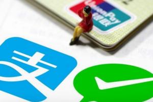 中国出境游客移动支付消费首次超现金